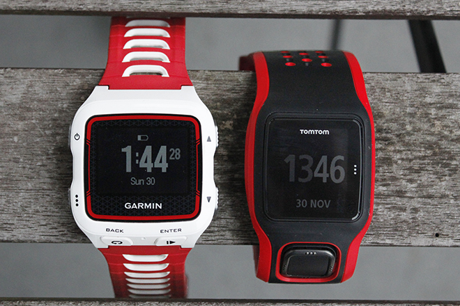 The TomTom Multsport and Garmin 920XT watches side by side.